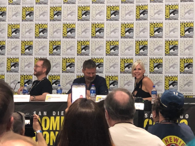 actors ben browder and gigi edgley in front of audience