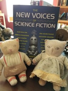 photo of New Voices of Science Fiction anthology next to Mr. and Mrs. Cat