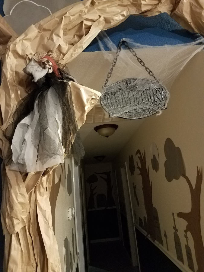 butcher paper tree with witch decoration in front of hallway